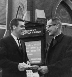Father Diersen receives deed to new building